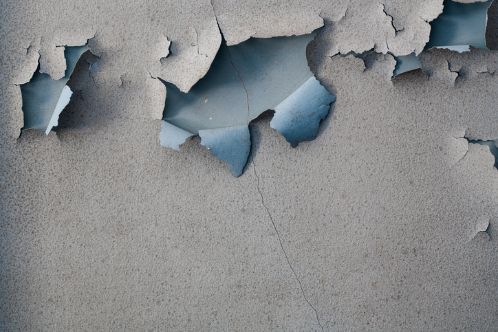 Paint peeling on an old plaster wall