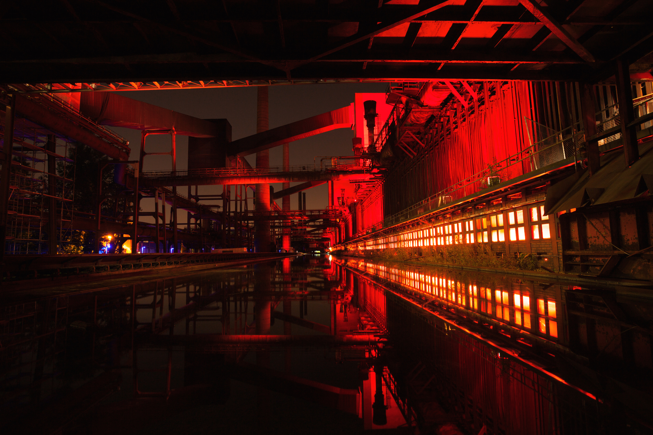 Coke oven Zollverein at night. Complex is illuminated and appears in red colors.