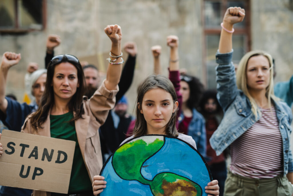 Adult and teen women protest for climate action